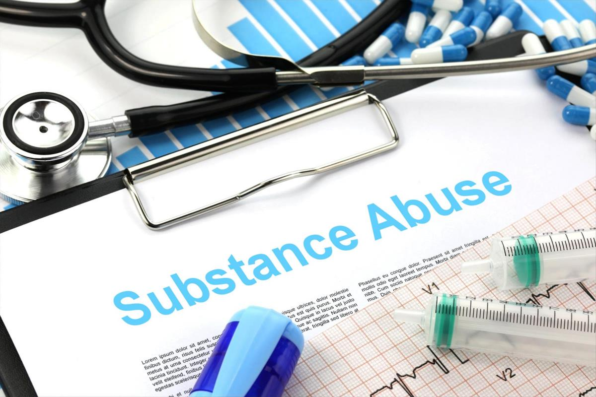 "Medical equipment surround a paper on a clip board titled ""substance abuse"""